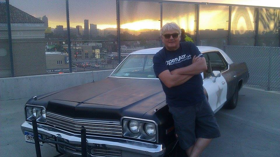"""<p>Mike Flanagan gets up close and personal with one of the (many) police cars featured in """"The Blues Brothers.""""</p>"""
