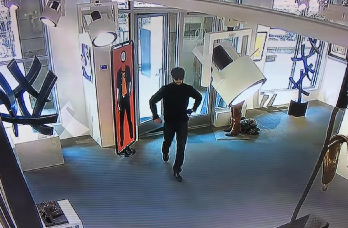 "<p>A screenshot from surveillance video shows a man suspected of slashingChristopher Wool's ""Untitled 2004"" paintingat theOpera Galleryin Aspen, Colorado.</p>"
