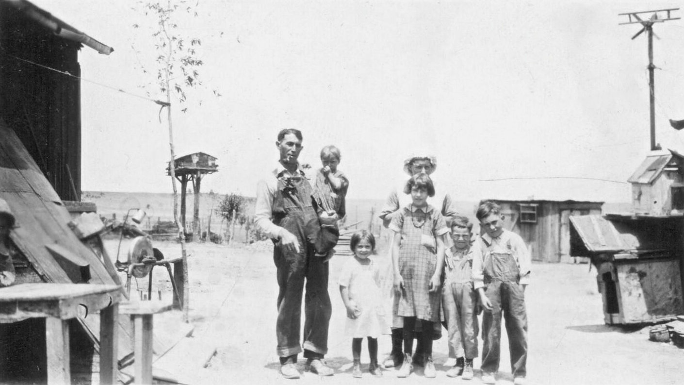 <p>Mary Petrucci stands behind her children Edna, Lucy, Frank, Joe while at the left, Thomas Petrucci holds the couple's baby Mary. This photo was taken around 1924 at the home Thomas built about mile south of the Ludlow Depot.</p>