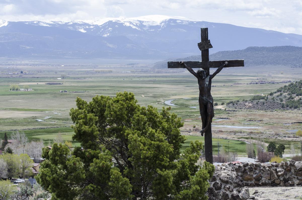 <p>A crucifix stands over San Luis, Colorado's oldest town.</p>
