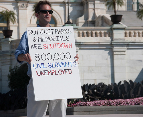 "<div><span style=""line-height: 1.66667em;"">In this recent photo, a man stands outside the U.S. Capitol building in Washington, D.C., to decry the government shutdown. </span></div>"