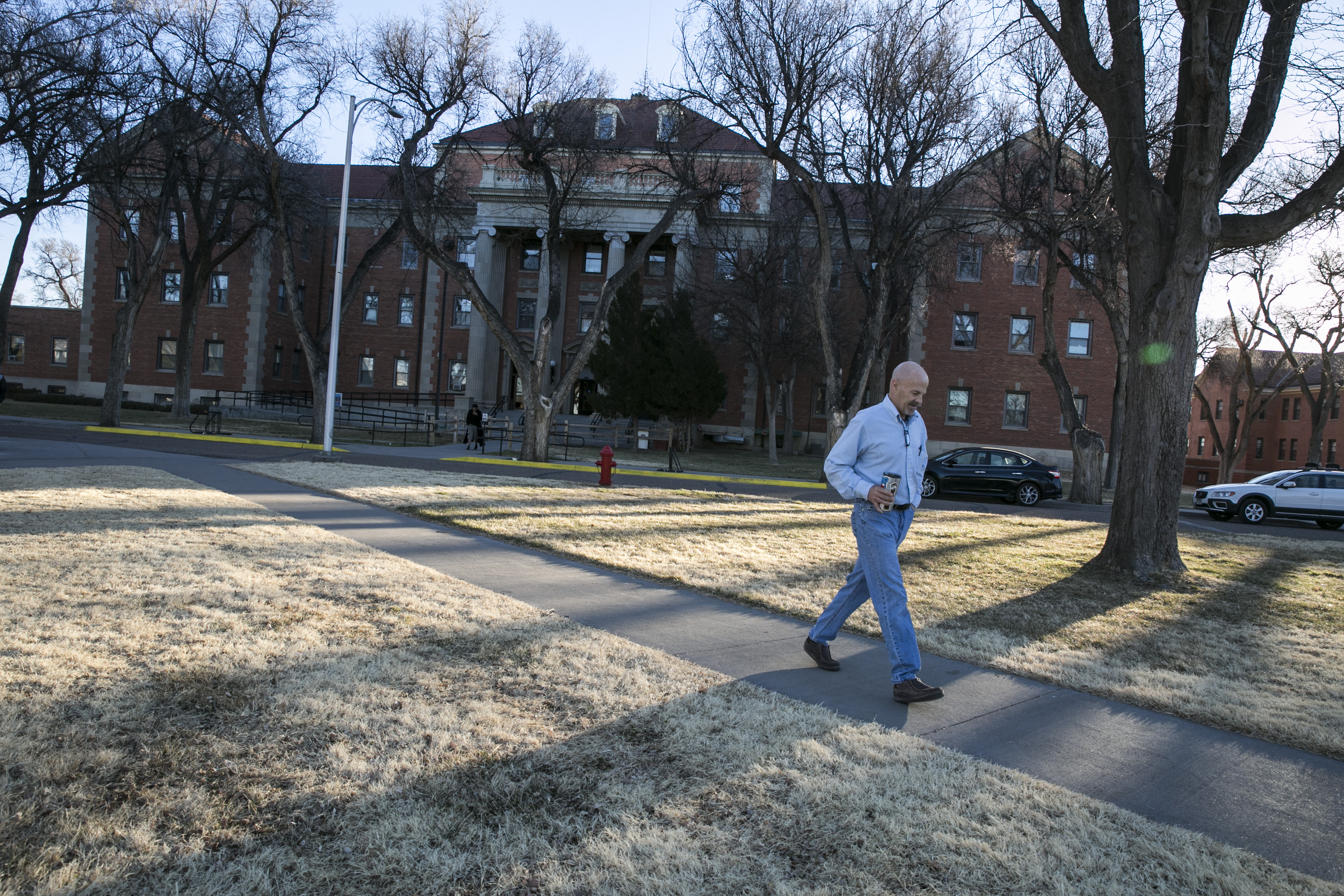 <p>Darren Fowler, a resident of Fort Lyon, takes an early morning walk through the campus east of Las Animas, Colo., Thursday, Feb. 23, 2017.</p>
