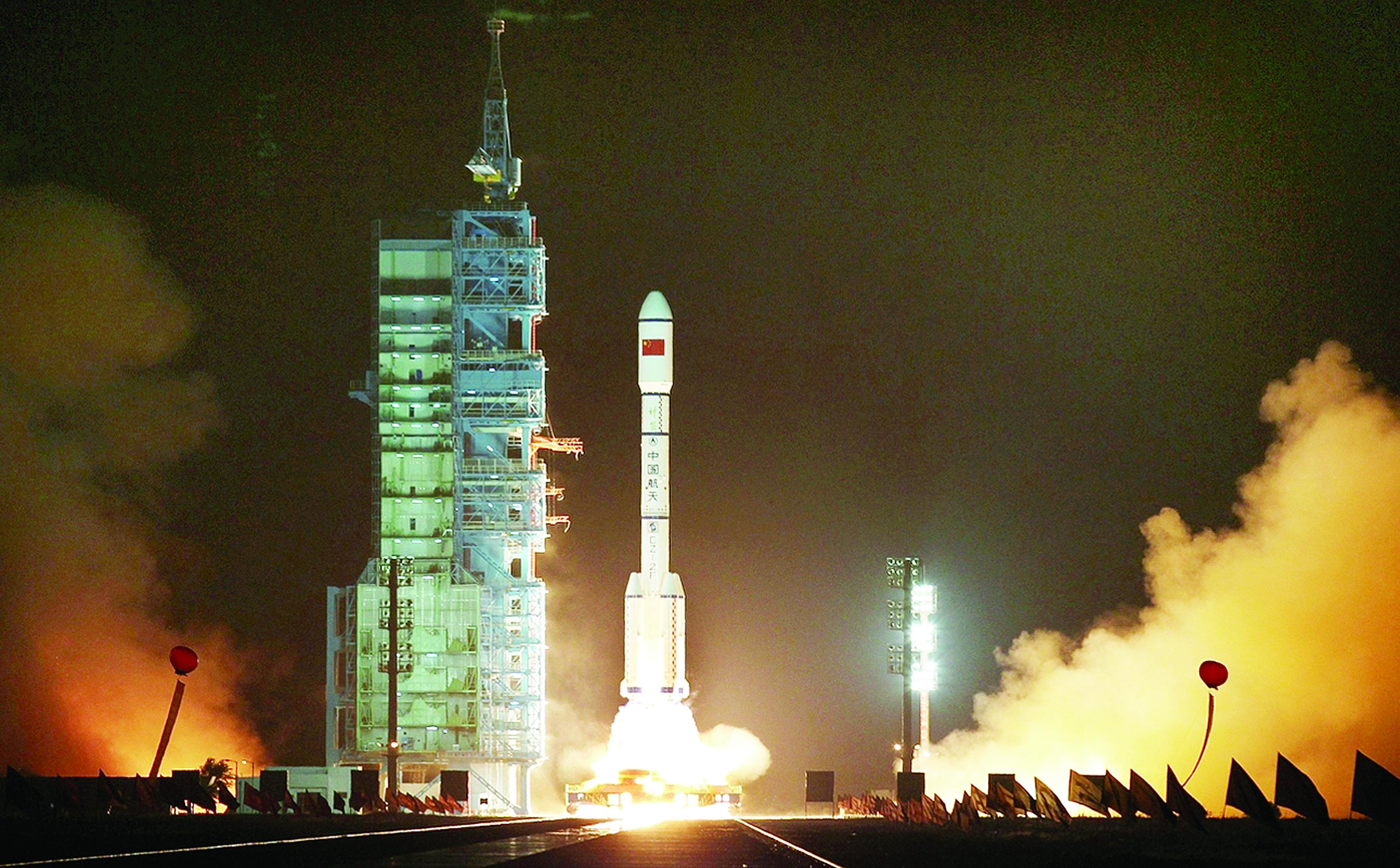 <p>The rocket carrying Tiangong-1 lifts off in 2011.</p>