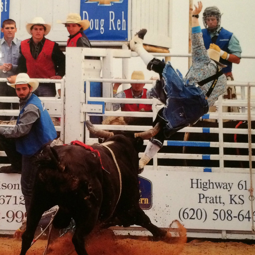 <p>Wacey Munsell, pictured right, avoids the horns of a bucking bull as best he can.</p>