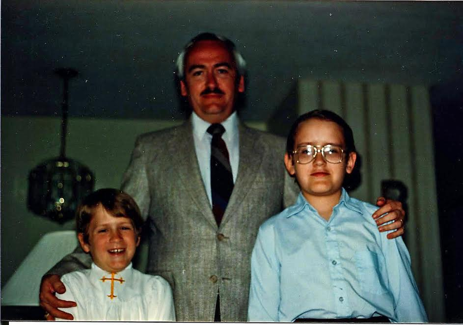 7-year-old Ben Roy, his father Bob Roy and older brother Rob Roy at Ben's first communion.