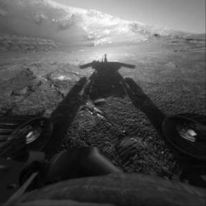 This dramatic image of NASA's Mars Exploration Rover Opportunity's shadow was taken on sol 180 (July 26, 2004) by the rover's front hazard-avoidance camera.