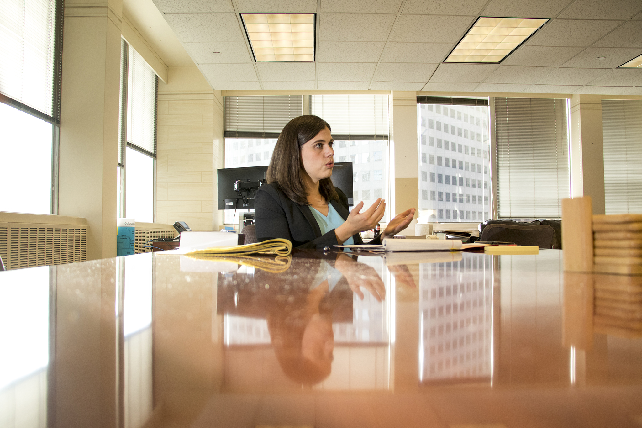 Secretary of State Jena Griswold speaks to a reporter in her office, Jan. 30, 2019.