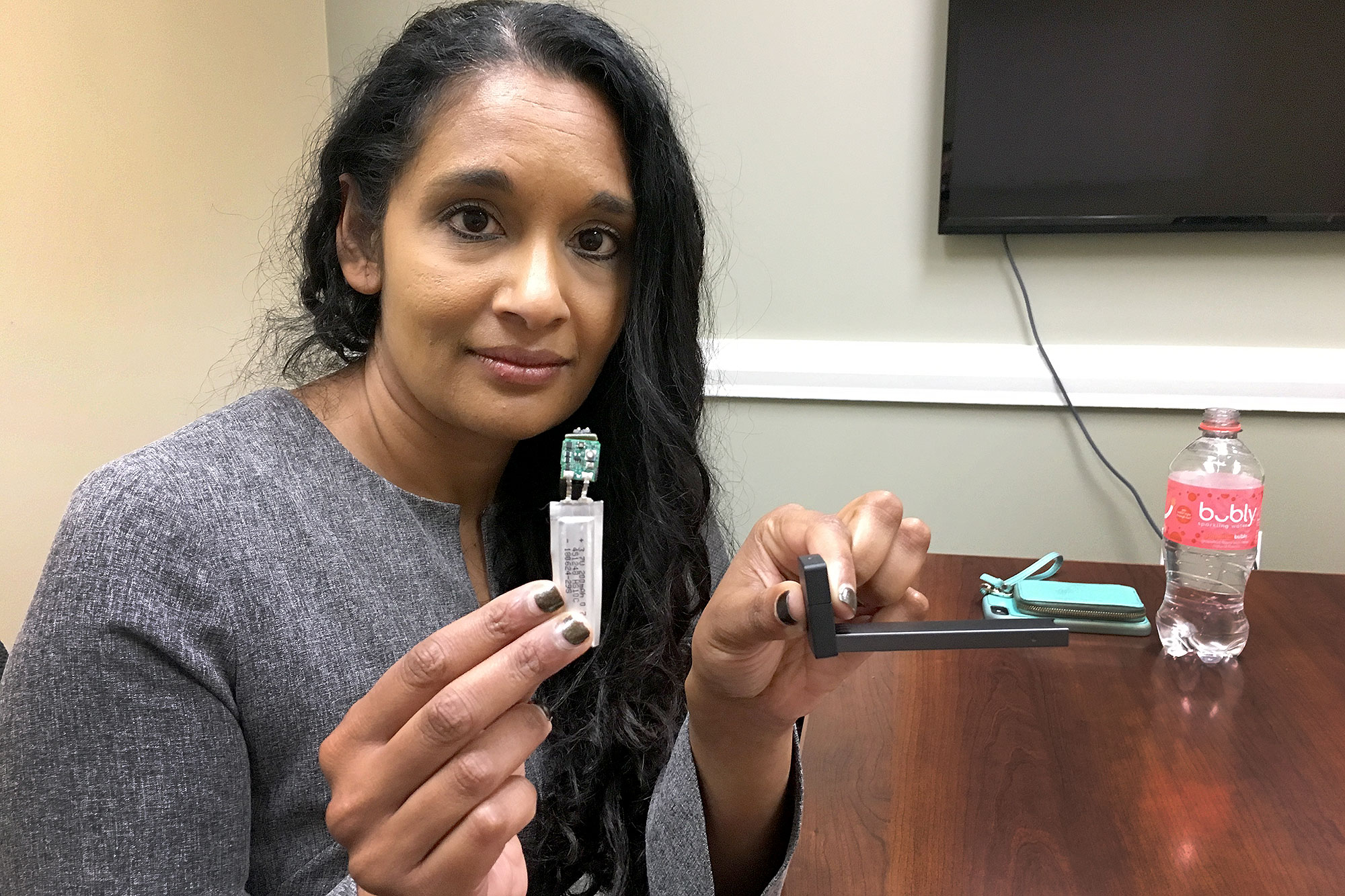 "<p class=""normal"">Tista Ghosh, Colorado's chief medical officer, displays a Juul's workings. </p>"