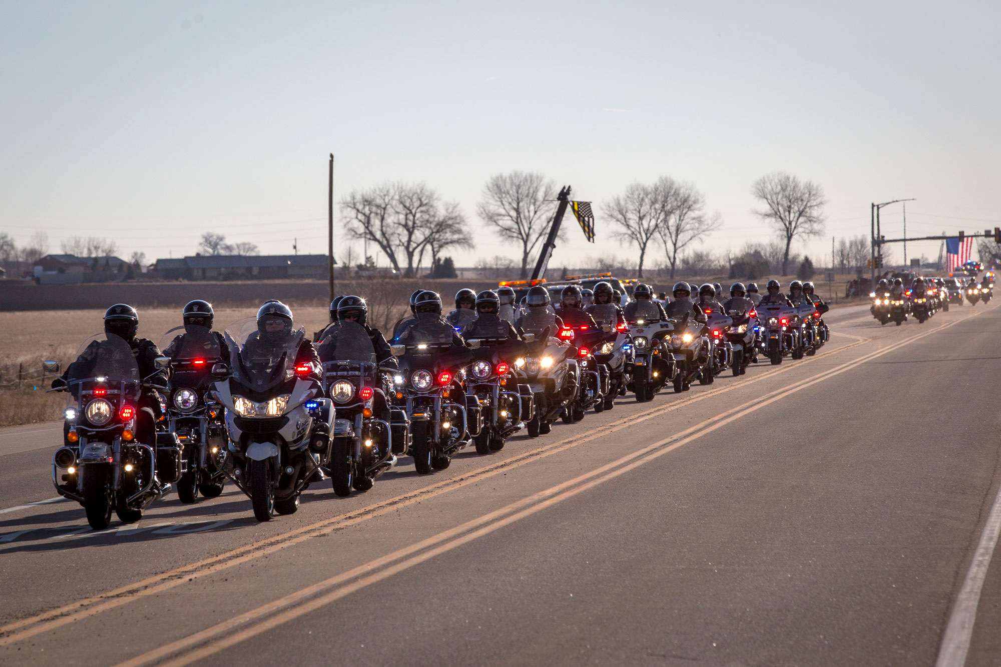 <p>A motorcycle escort leads the funeral procession of CSP Cpl. DanGroves in Longmont on Thursday morning, March 21, 2019.</p>