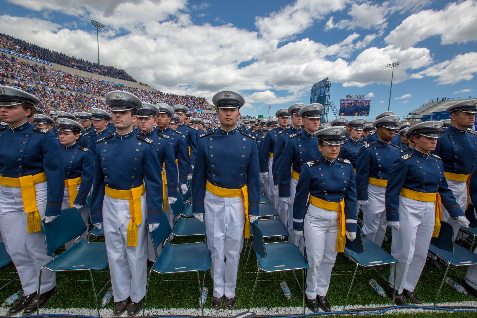 U.S. Air Force Academy graduates stand at their seats at their commencement ceremony on Thursday, May 30.