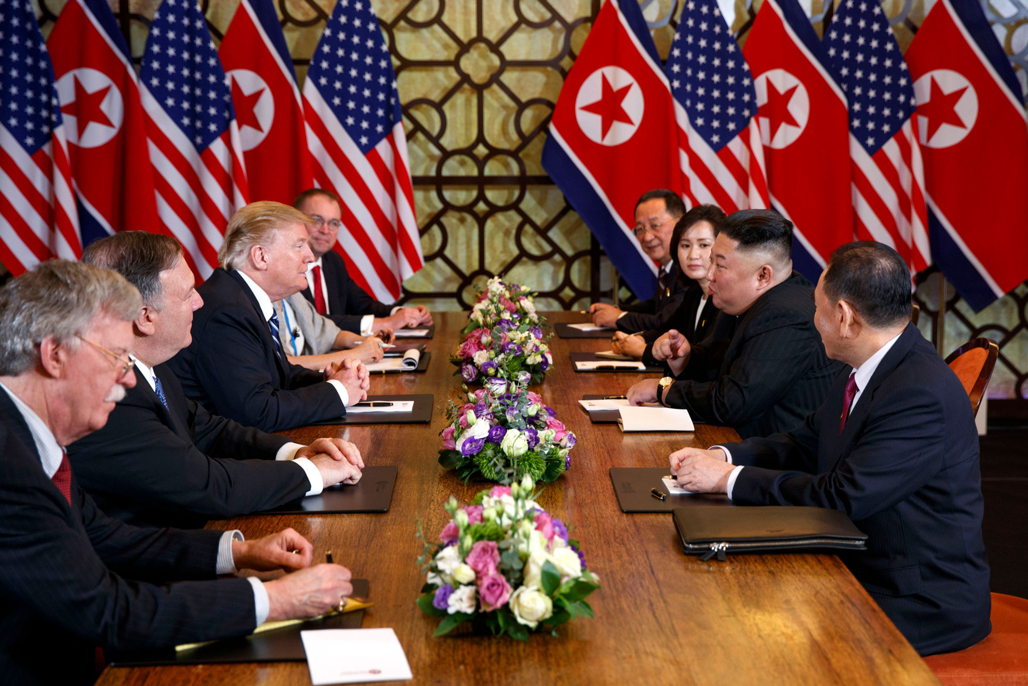 In this Feb. 28, 2019, file photo, U.S. President Donald Trump, third from left, speaks with National Security adviser John Bolton, left, and Secretary of State Mike Pompeo, second from left, during a meeting with North Korean leader Kim Jong Un, second from right, in Hanoi, Vietnam. Kim is cautiously turning up the heat after his unsuccessful summit with Trump in Hanoi two months ago.