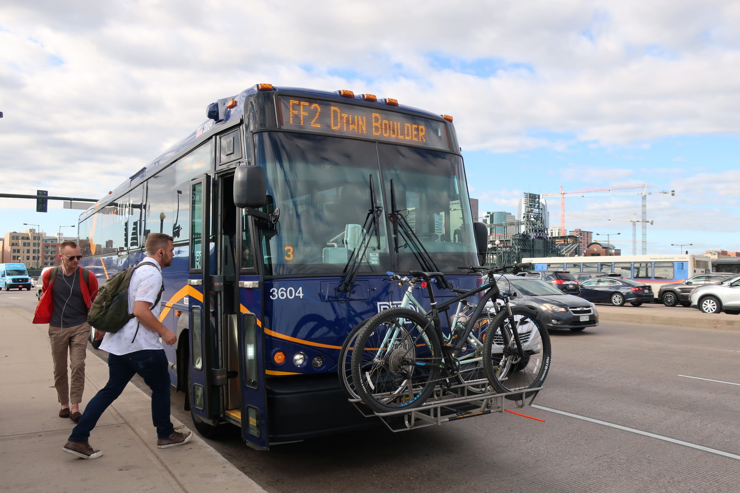 Passengers board the RTD Flatiron Flyer bus in downtown Denver on its way to Boulder on Friday, June 21, 2019