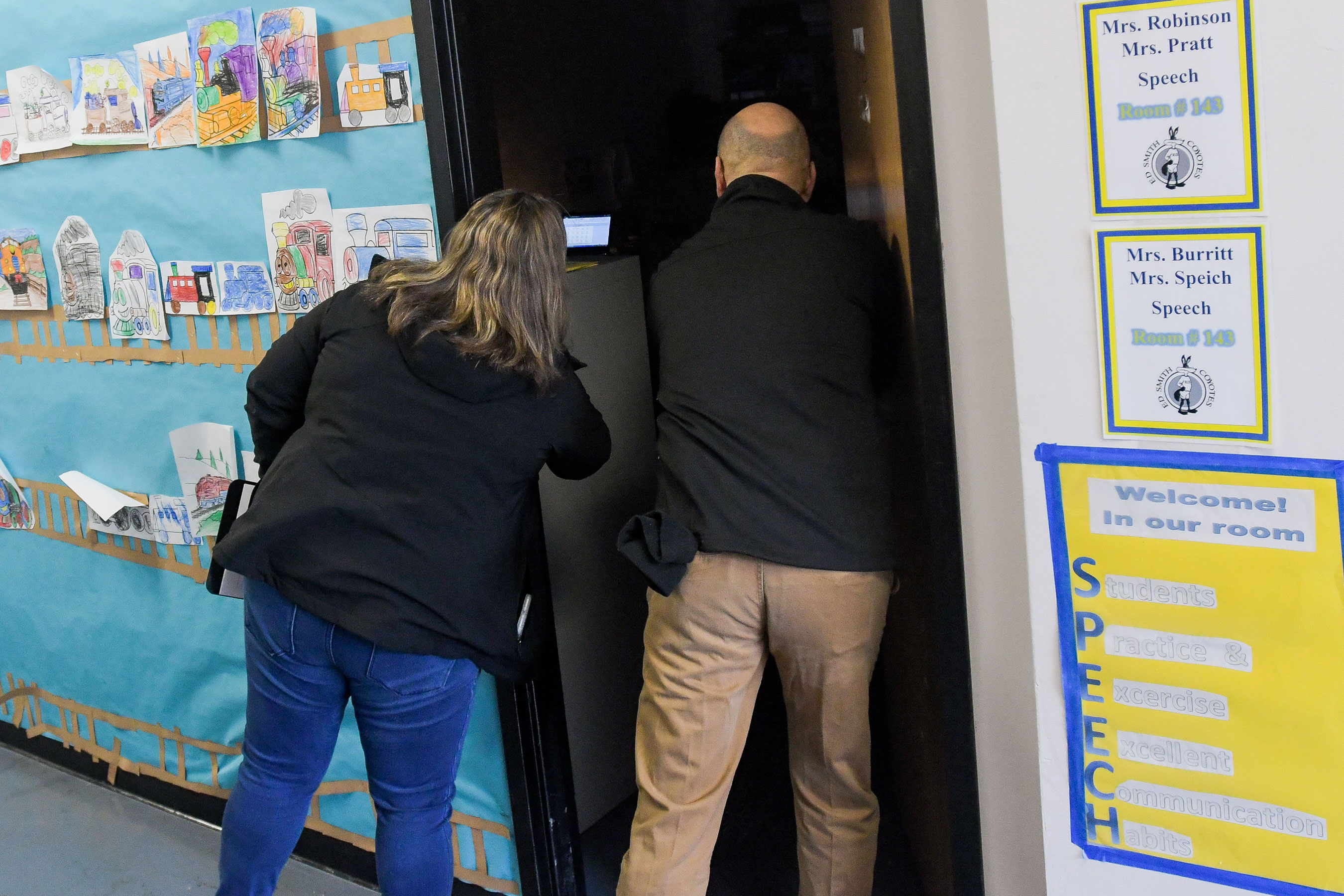 <p>Jaclyn Schildkraut checks a classroom during a lockdown drill at Ed Smith Elementary School in Syracuse, New York on Monday, March 11, 2019.</p>