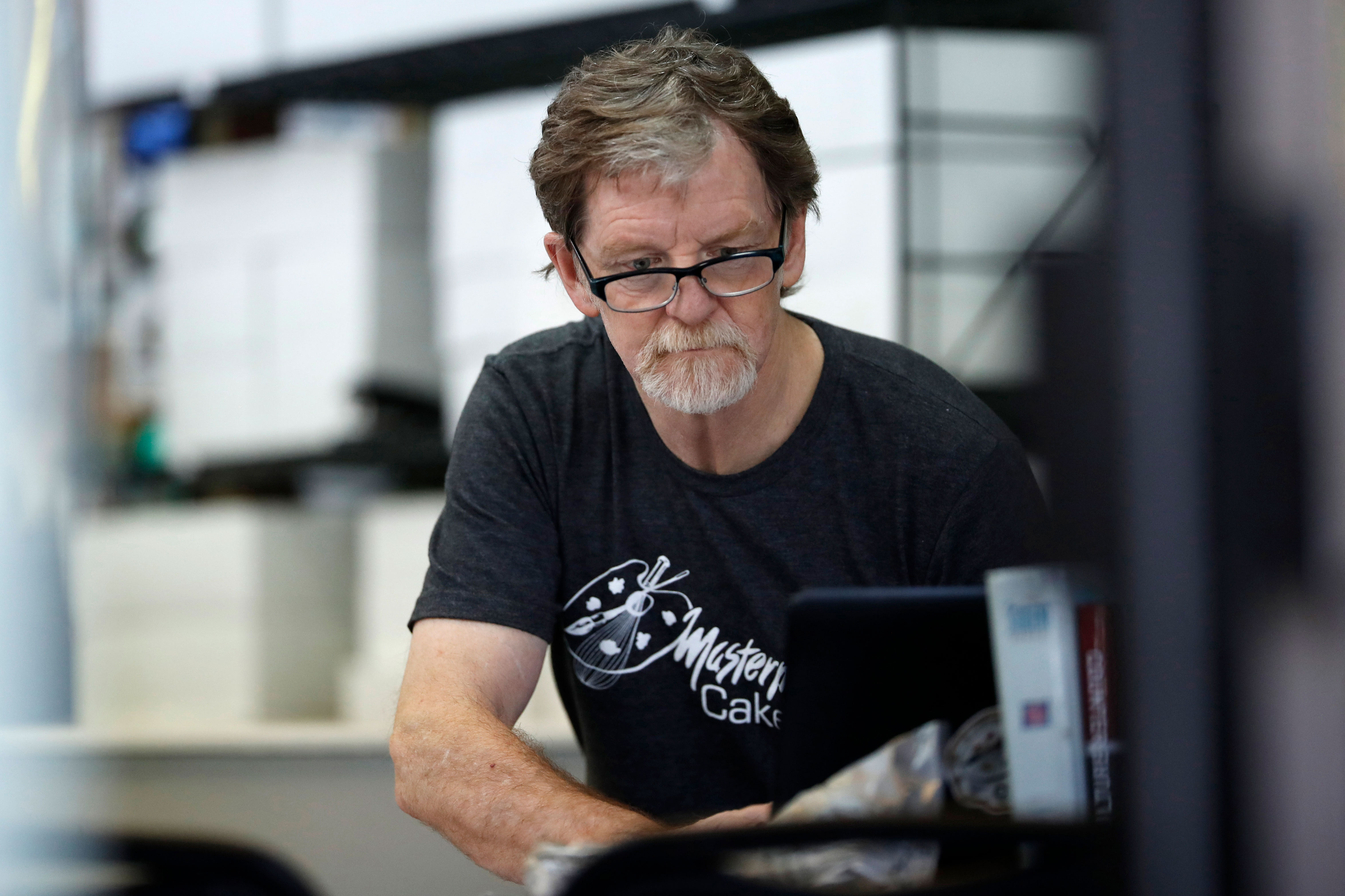 <p>Baker Jack Phillips, owner of Masterpiece Cakeshop, manages his shop, June 4, 2018.</p>