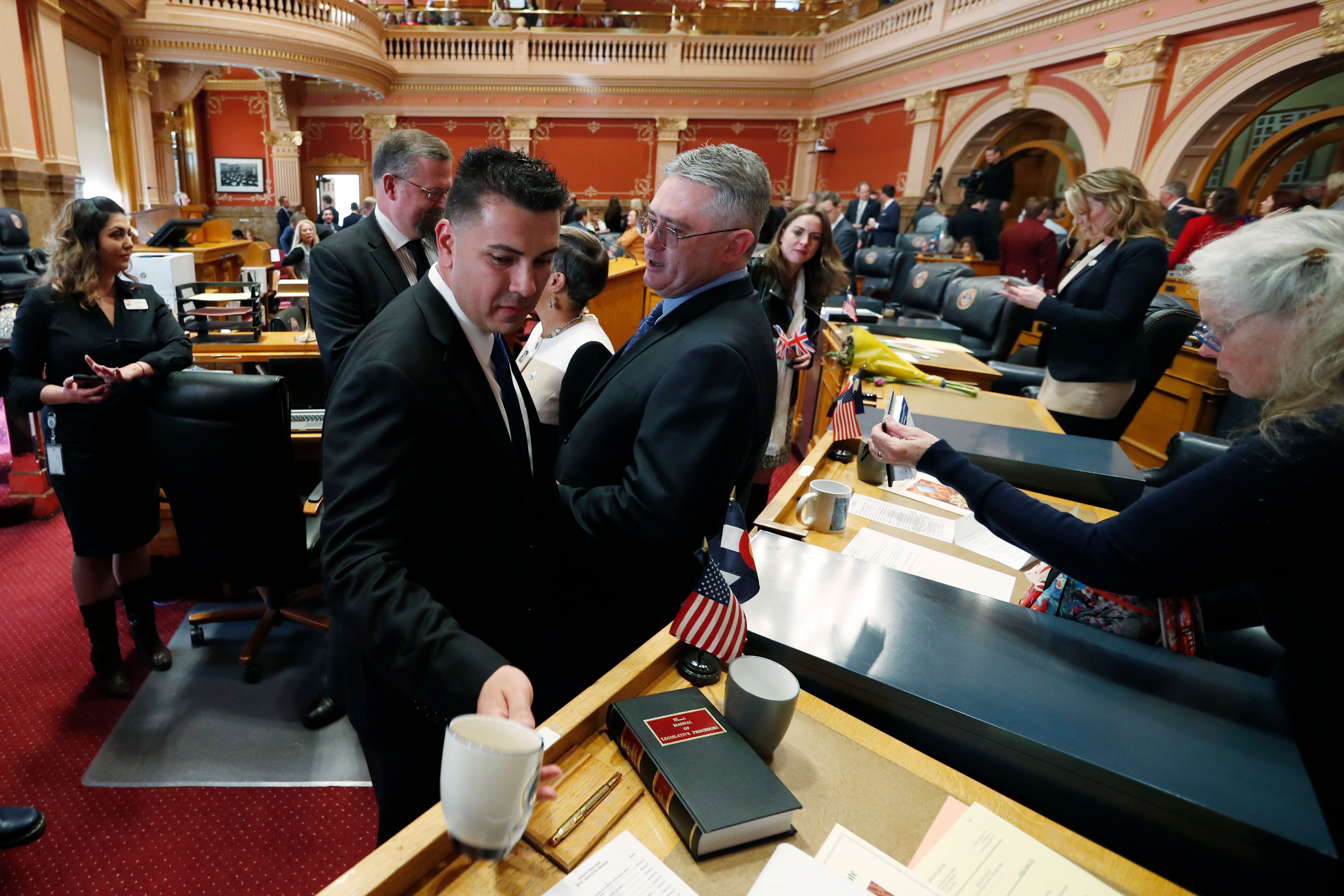 Colorado Senate President Leroy Garcia, D-Pueblo, left, confers with state Sen. Chris Holbert, R-Castle Rock, in the Senate chamber in the State Capitol, Friday, Jan. 4, 2019, in Denver.