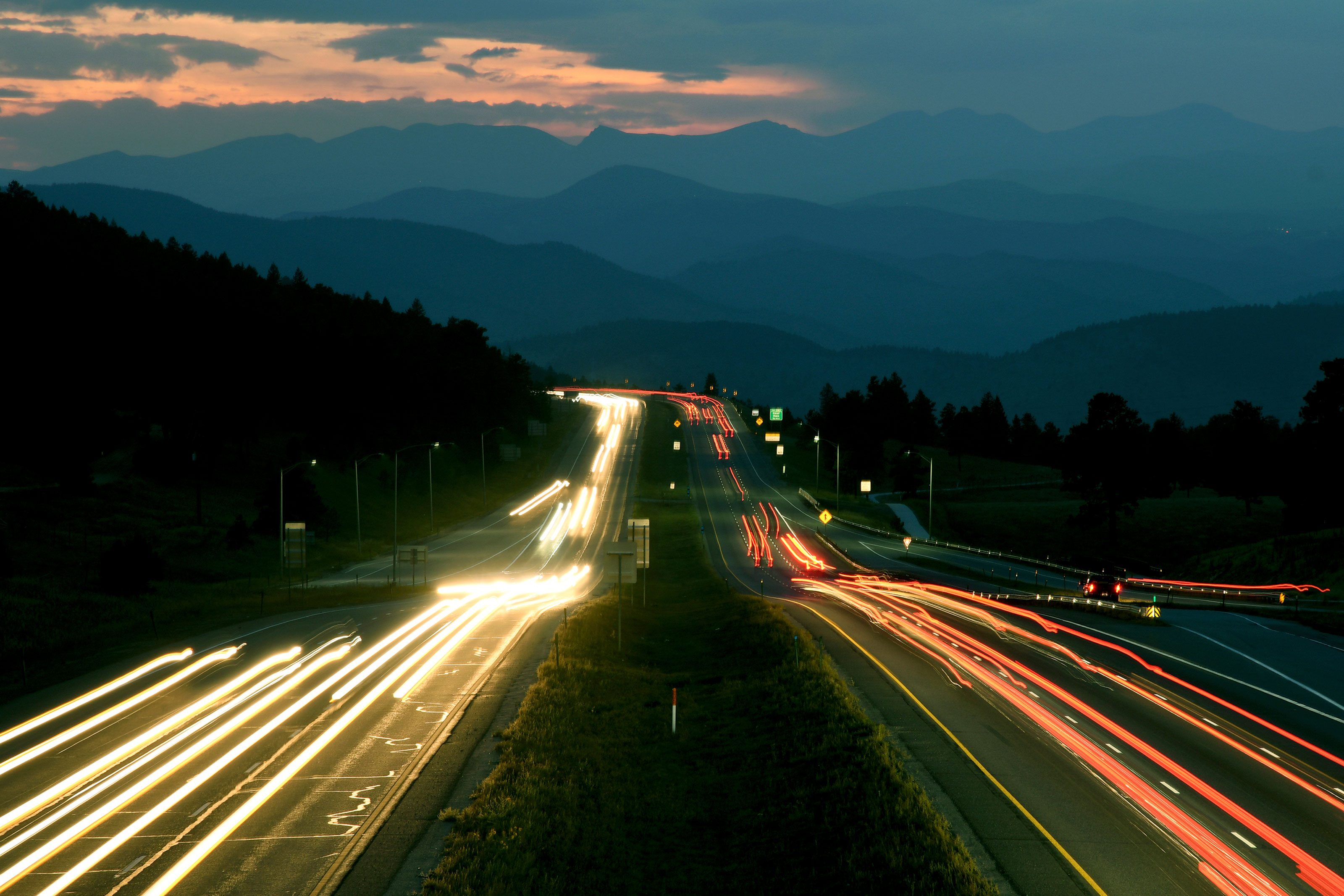In this Sept. 8, 2017 time exposure photo, the sun sets as traffic moves along Interstate 70 west of Denver.