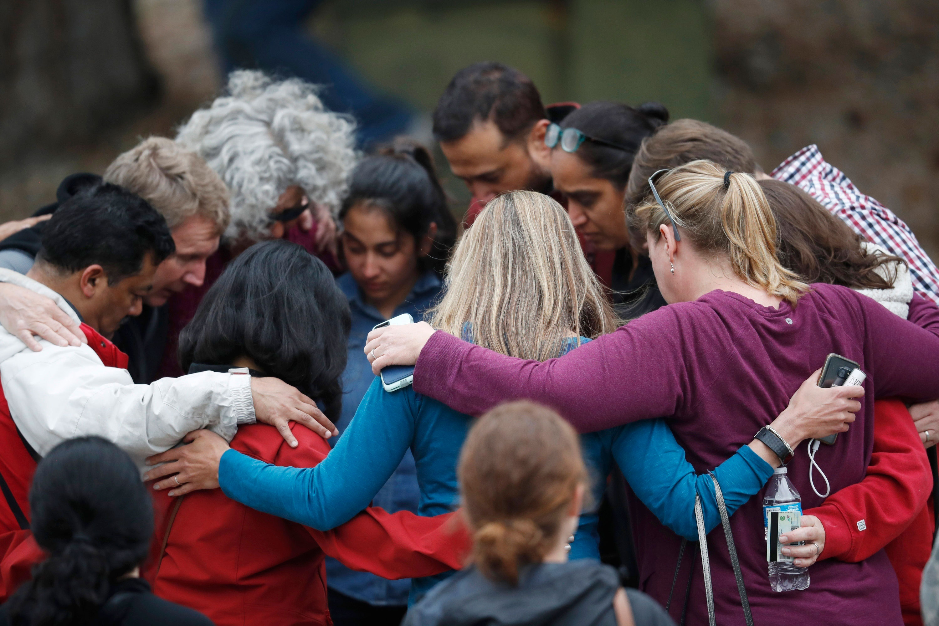 <p>Parents gather in a circle to pray at a recreation center where students were reunited with their parents after a shooting at a suburban Denver middle school Tuesday, May 7, 2019, in Highlands Ranch, Colo.</p>