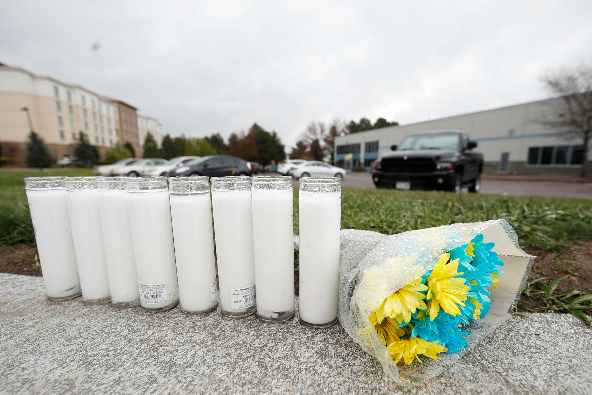A bouquet of flowers sits next to a row of candles outside the STEM School Highlands Ranch late Wednesday, May 8, 2019, in Highlands Ranch, Colo. A fatal shooting took place Tuesday at the charter school south of Denver.