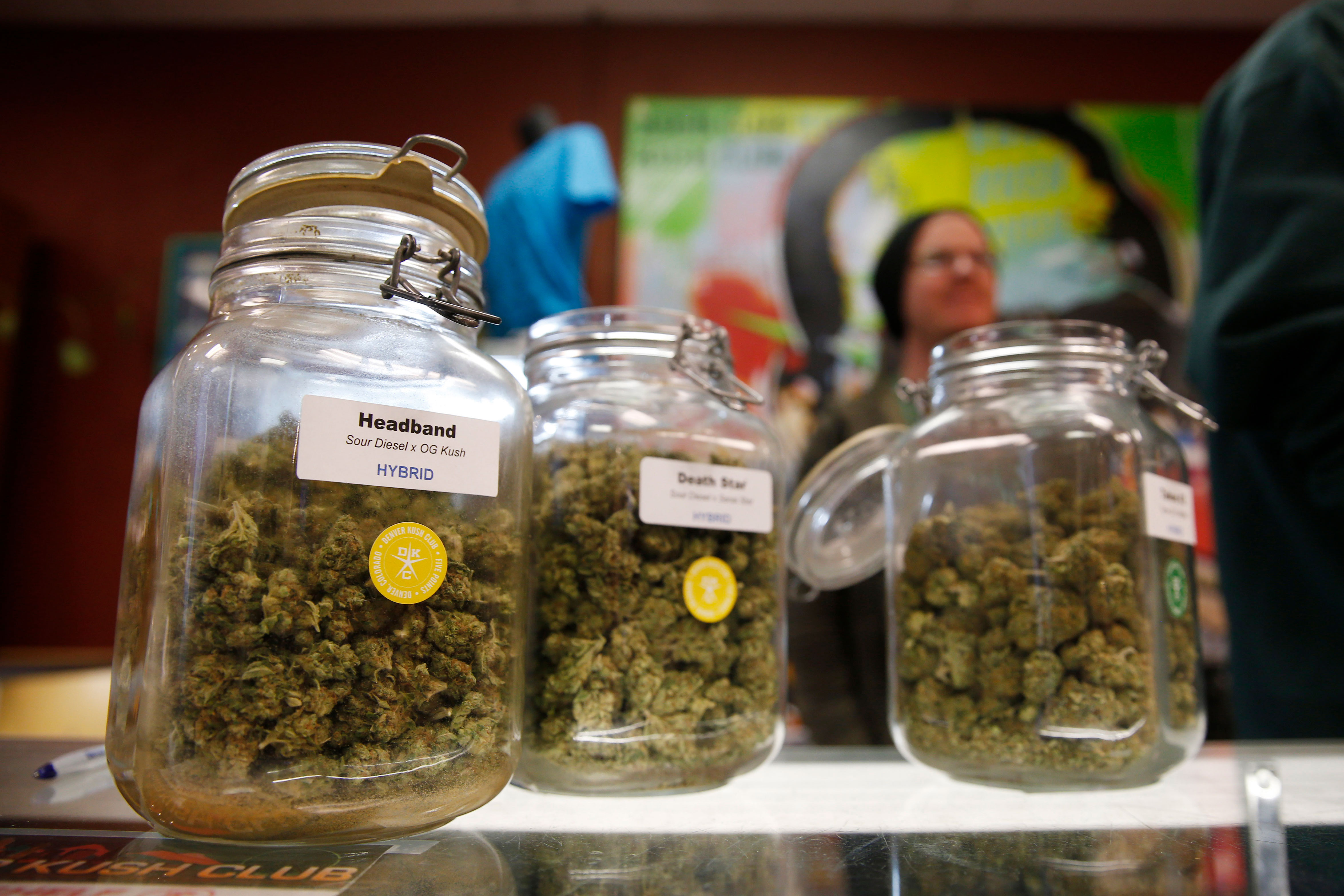 Jars of different type of marijuana sit on counter during a sale at the Denver Kush Club in north Denver, Nov. 27, 2015.