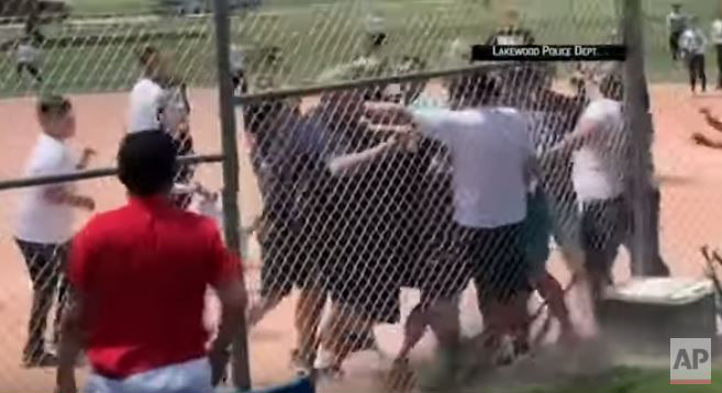 <p>A screen shot from a video of adults brawling at a baseball game played by 7-year-olds that was released by Lakewood police. </p>