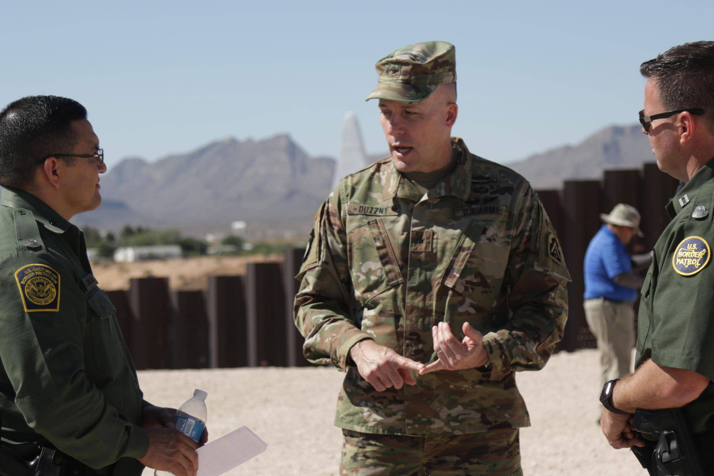 <p>Army Brig. Gen. Walter Duzzny speaks to border patrol agents in Sunland Park, N.M. during a June media event at the U.S. Mexico border.</p>