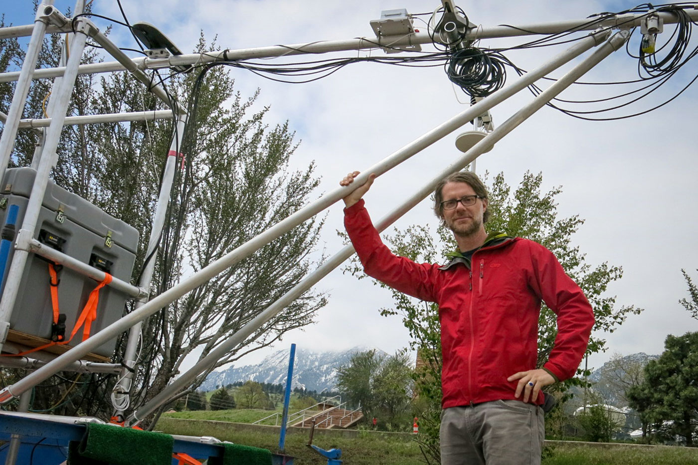 <p>Matt Shupe, a senior research scientist with the University of Colorado Boulder's Cooperative Institute for Research in Environmental Sciences, stands in front of a research sled he plans to use in the Arctic. It measures things like heat, temperature and wind speed.</p>