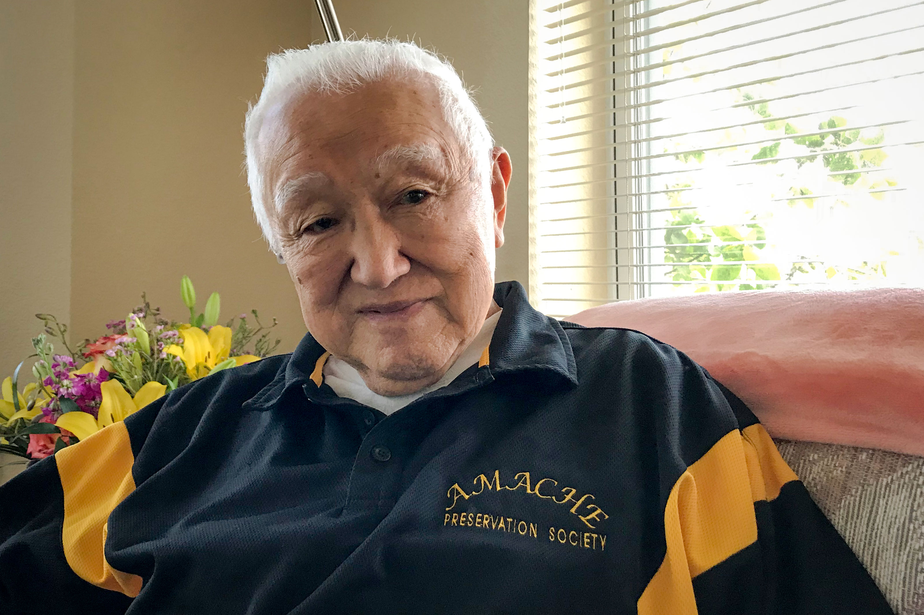 In this file photo, Bob Fuchigami sits in his Lakewood home. He and his family were held in internment camps by the US government for more than 3 years in  during World War II.