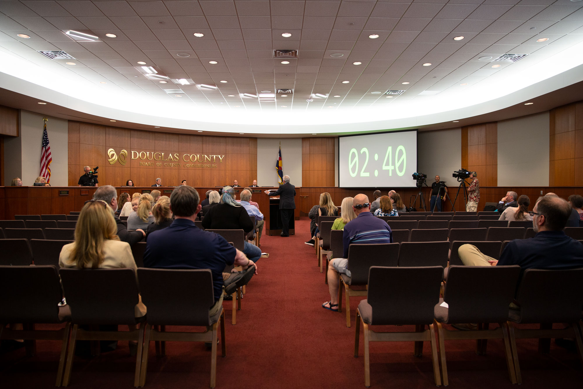<p>Audience members listen to a public speaker at a Monday, May 13, Douglas County Commissioners meeting to discuss a budget proposal to fund school safety.</p>