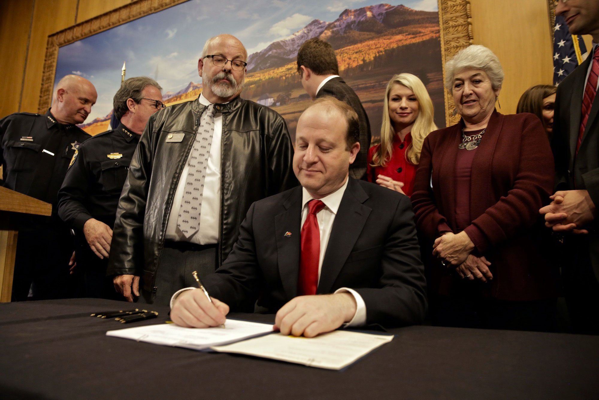 """<p>As state Rep. Tom Sullivan looks on, Colorado Gov. Jared Polis signs into law HB 1177 Friday, April 12, 2019, making Colorado the 15th state in the country to have a so-called """"red flag"""" gun law. Sullivan was elected in November and was one of the bill's sponsors. He got involved in politics after his son Alex was killed in the Aurora Theater shooting.</p>"""