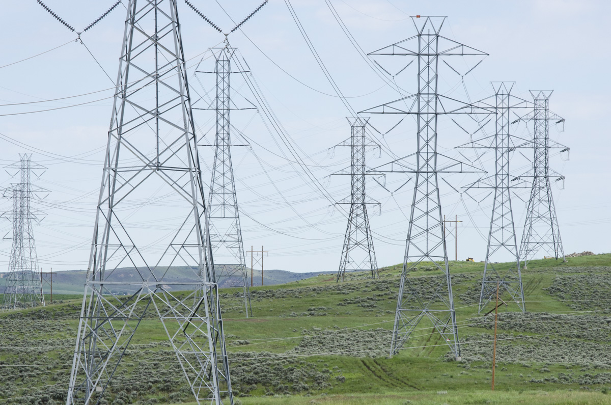 <p>Electrical transmissions lines carry power from the Craig Station coal-fired power plant near Craig, Colo. on Tuesday, June 16, 2015.</p>
