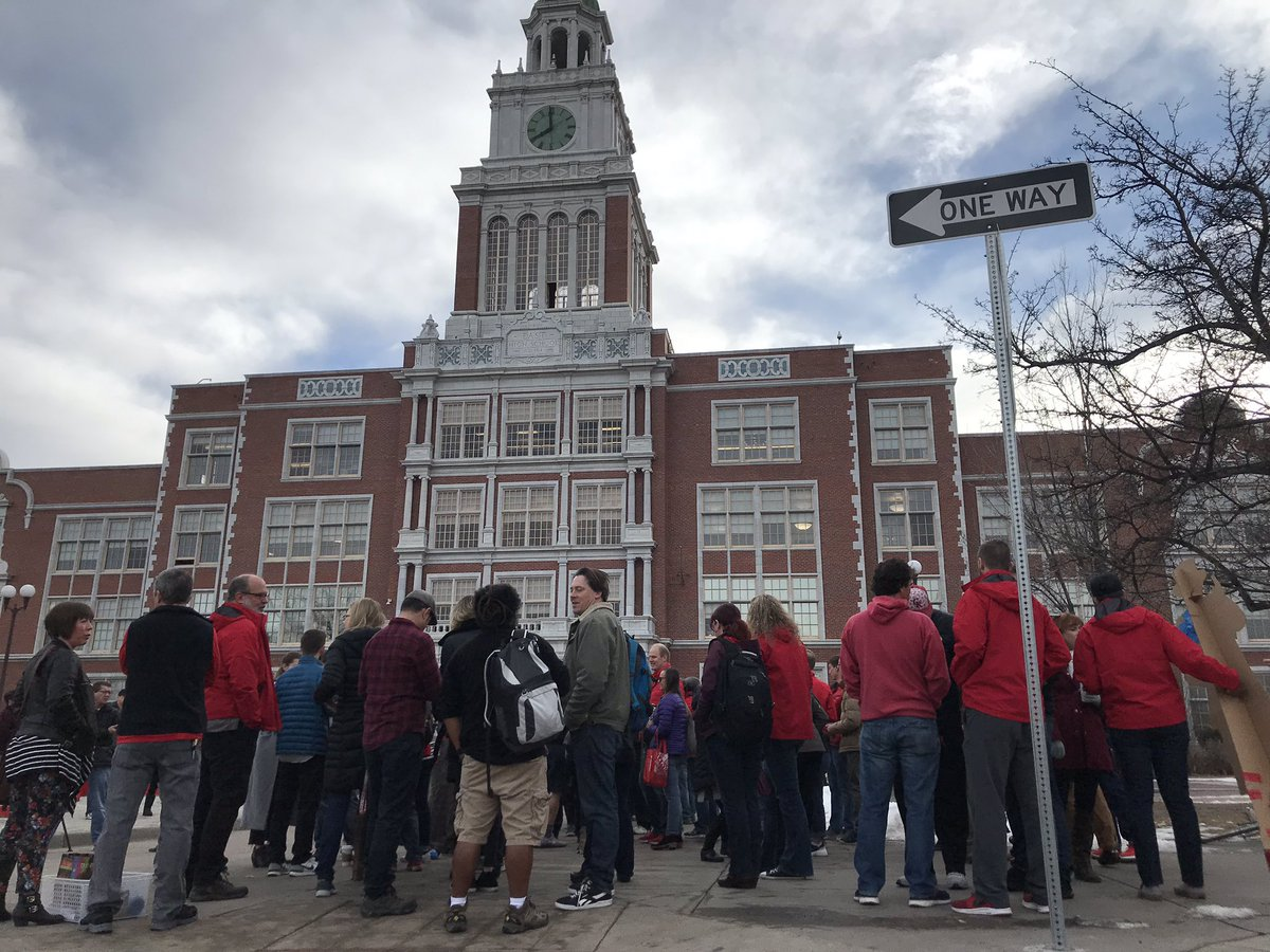 <p>Teachers gather outside East High School on Thursday, Feb. 14, 2018, just hours after an all-night bargaining session ended the Denver teach strike.</p>