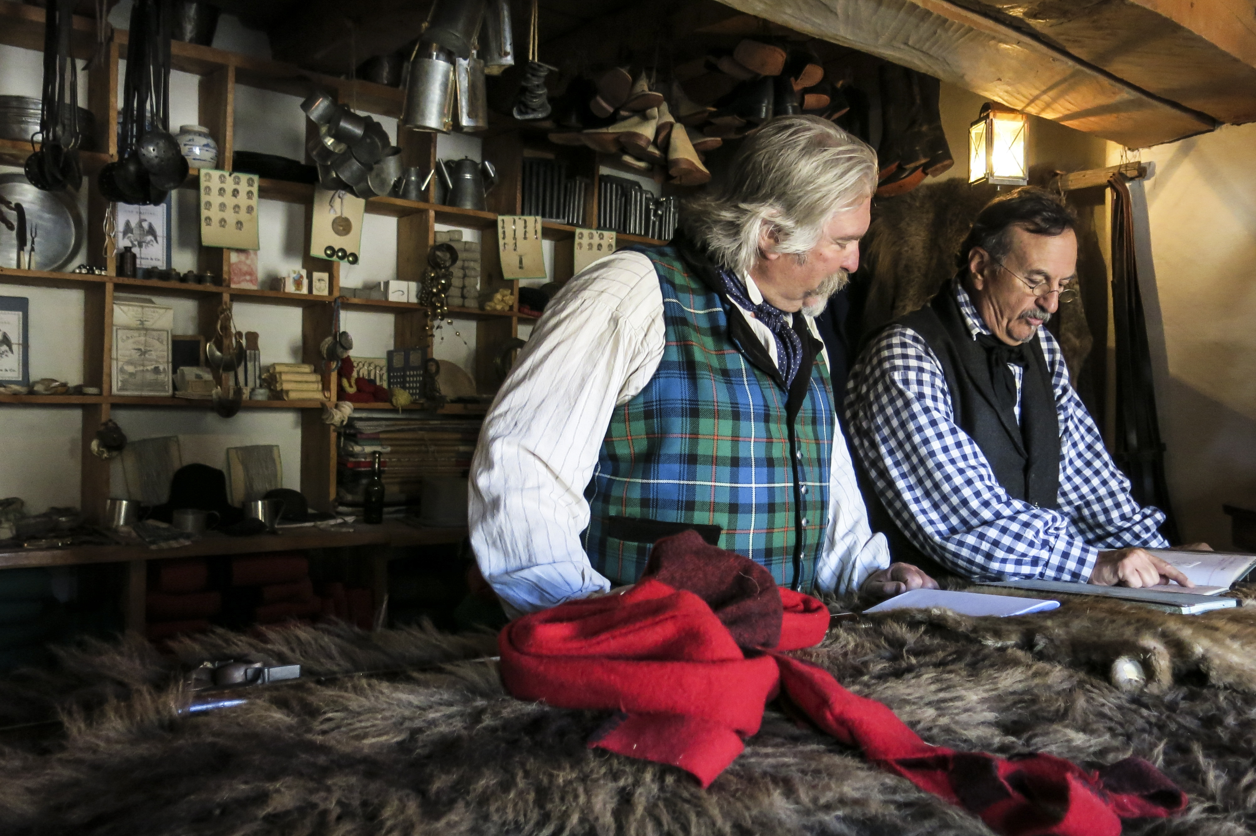 <p>Two historical interpreters review inventory in the fort store. Ledgers from trading posts like Bent's give historians and re-enactors vital clues into the equipment frontiersman relied on from year to year.</p>