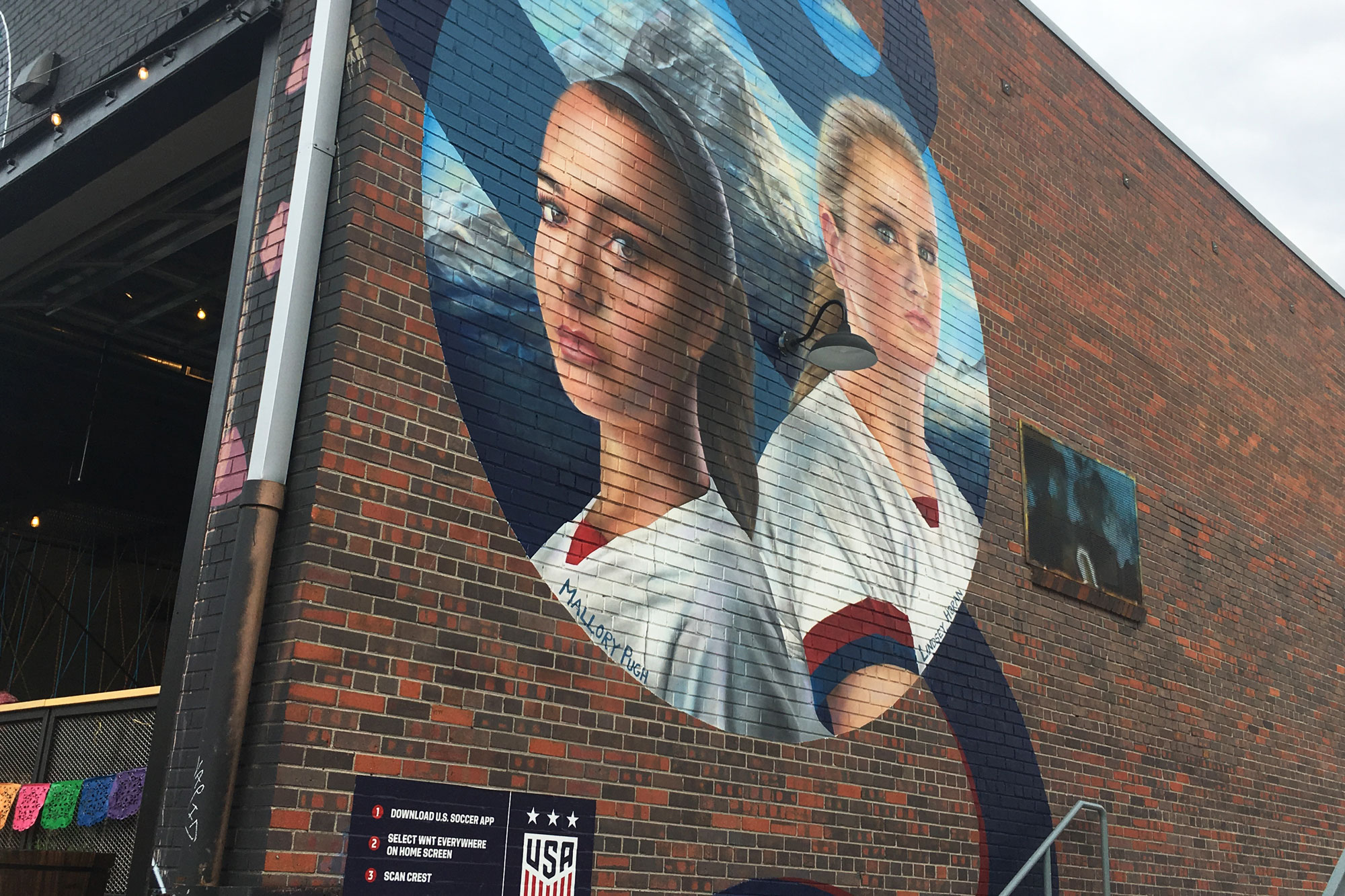 <p>A mural by artist Marissa Napoletano depicts Lindsey Horan and Mallory Pugh on the side of Improper City Brewery in Denver.</p>