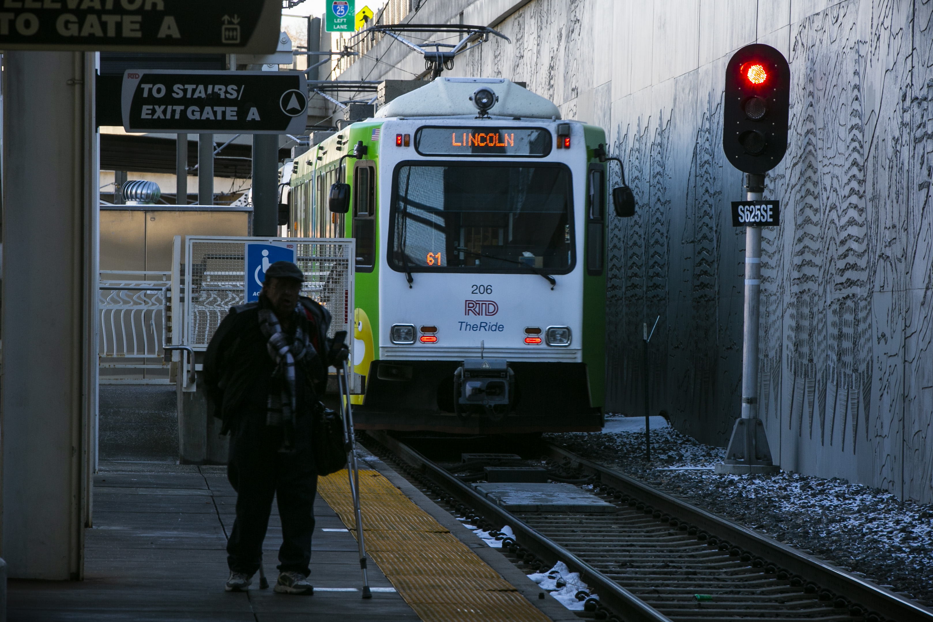 <p>An RTD light rail train passes a traffic signal as it leaves the Louisiana-Pearl station in south Denver on Tuesday, Jan. 16, 2018. This train did not violate the red signal; it was green when the operator began to leave the station.</p>