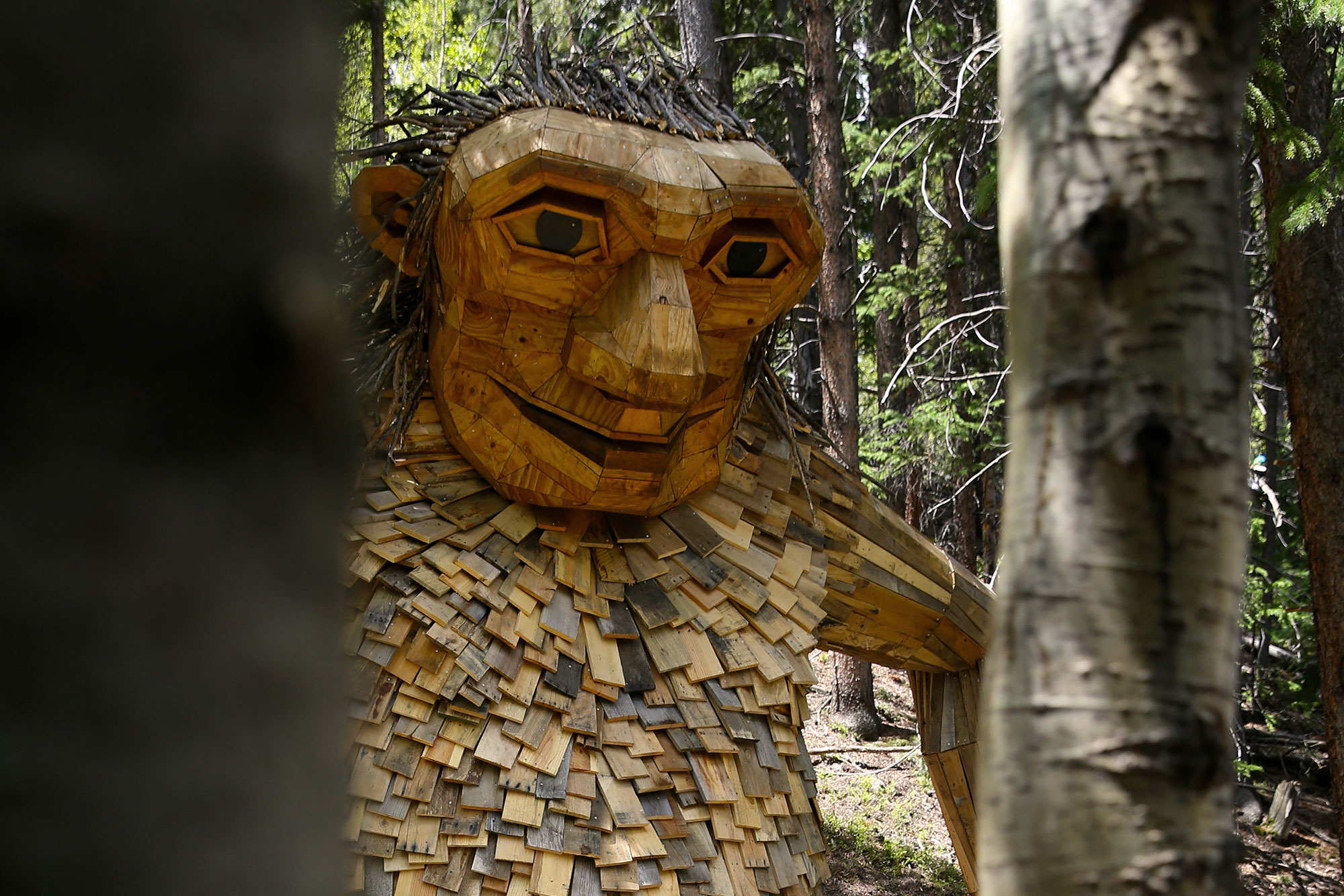 <p>The troll sculpture known as Isak Heartstoneis now more upright, bracing itself against a tree, in its new location.</p>