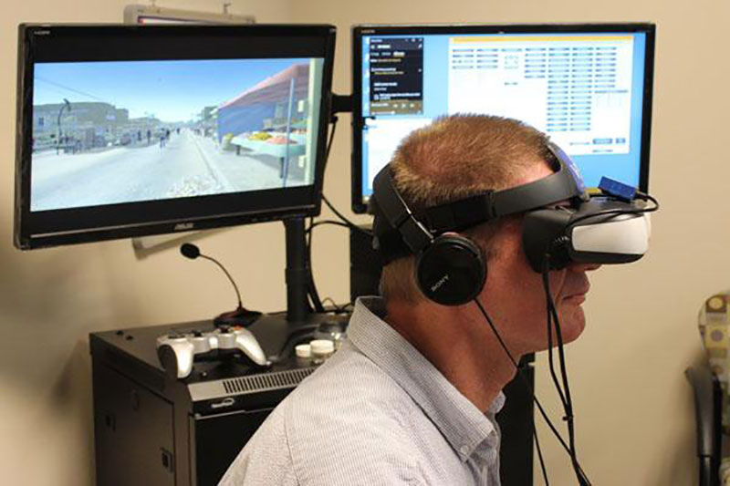 <p>Therapist Keith Smith demonstrates virtual reality equipment at the University of Central Florida. Smith uses virtual reality to help treat veterans' post traumatic stress disorder.</p>