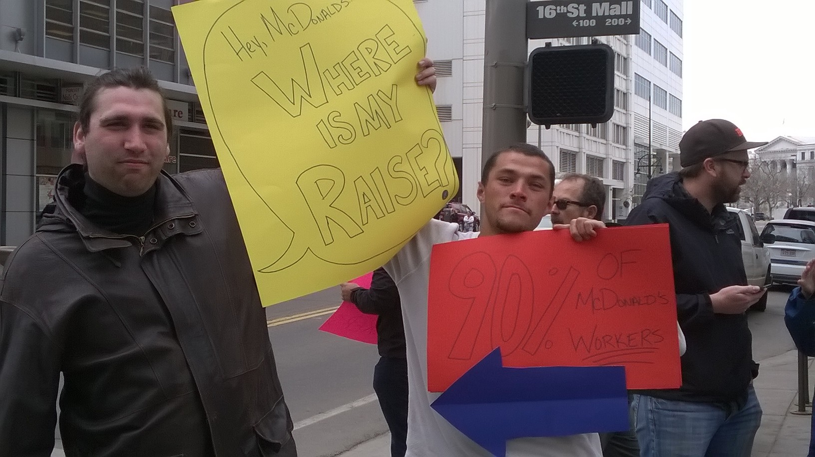 <p>Fast food workers Andrew Olson of Aurora and Patrick Ulibarri of Denver rallied for higher wages outside a downtown Denver McDonald's on April 2.</p>