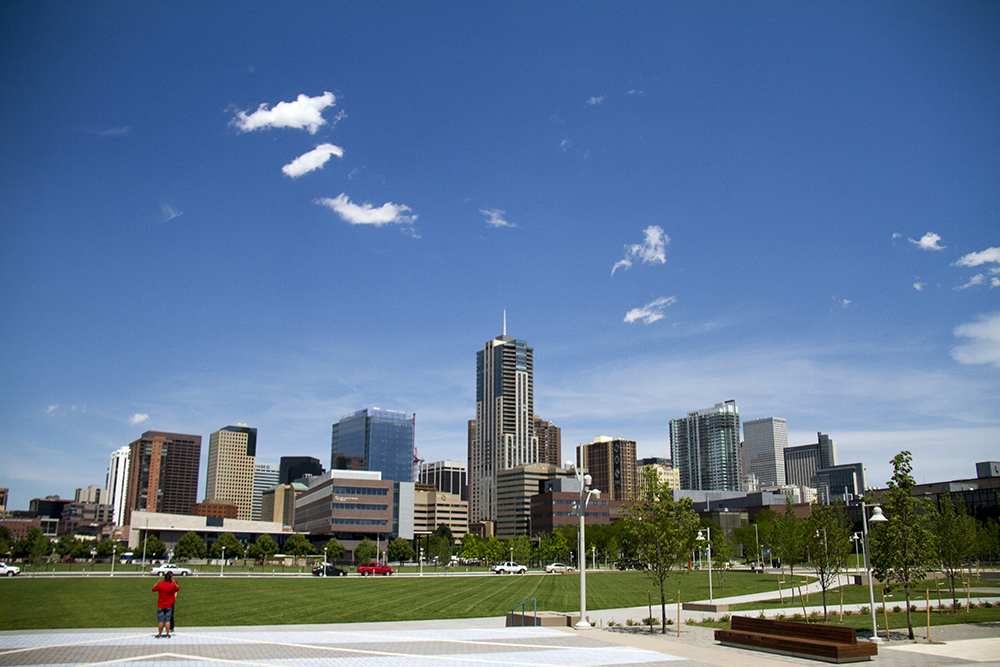 The downtown Denver skyline as seen from the Tivoli Brewing taphouse's patio on the Auraria campus. (Kevin J. Beaty/Denverite)