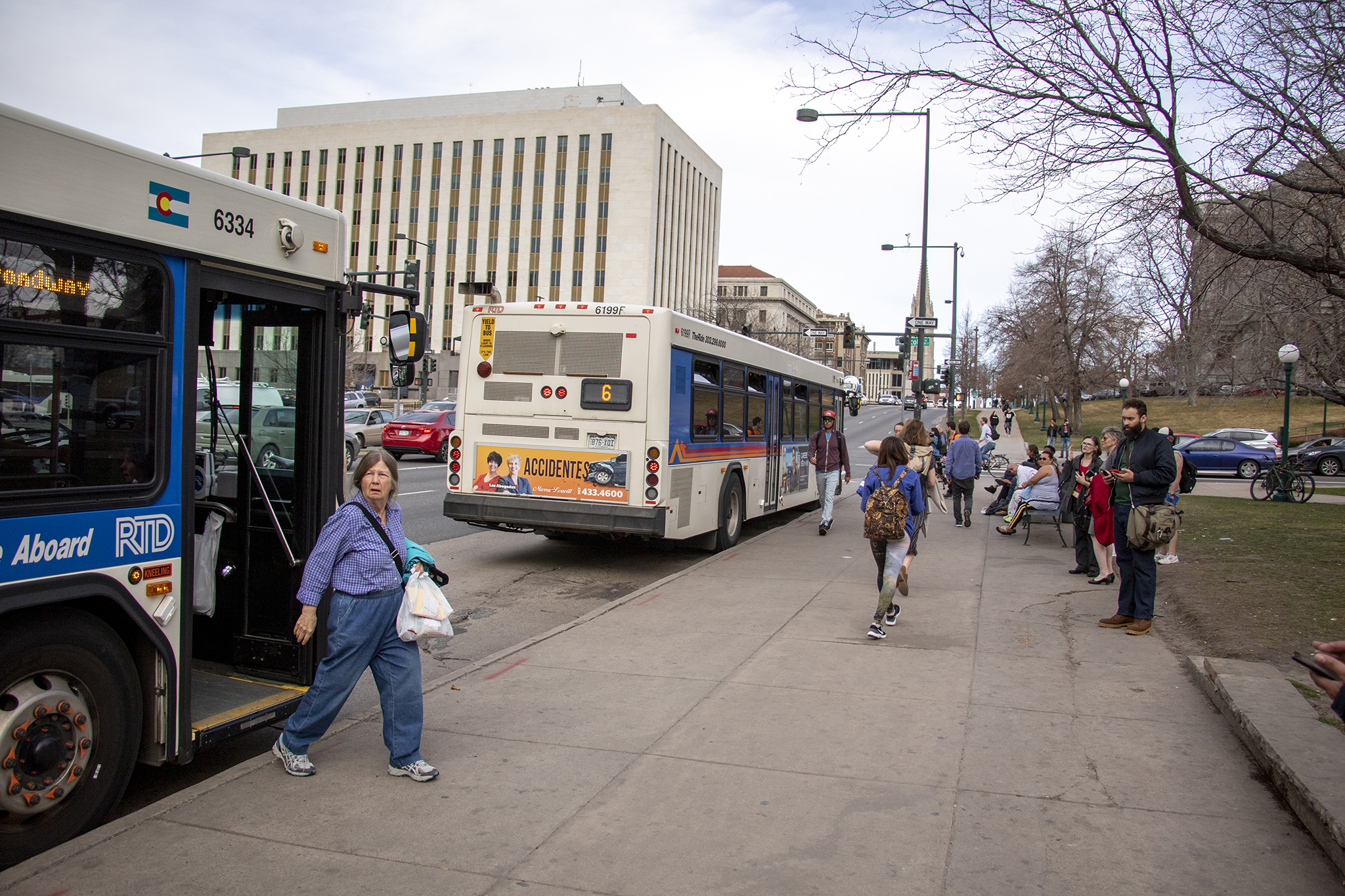 The RTD bus stop on Colfax Avenue at Broadway, March 28, 2019.
