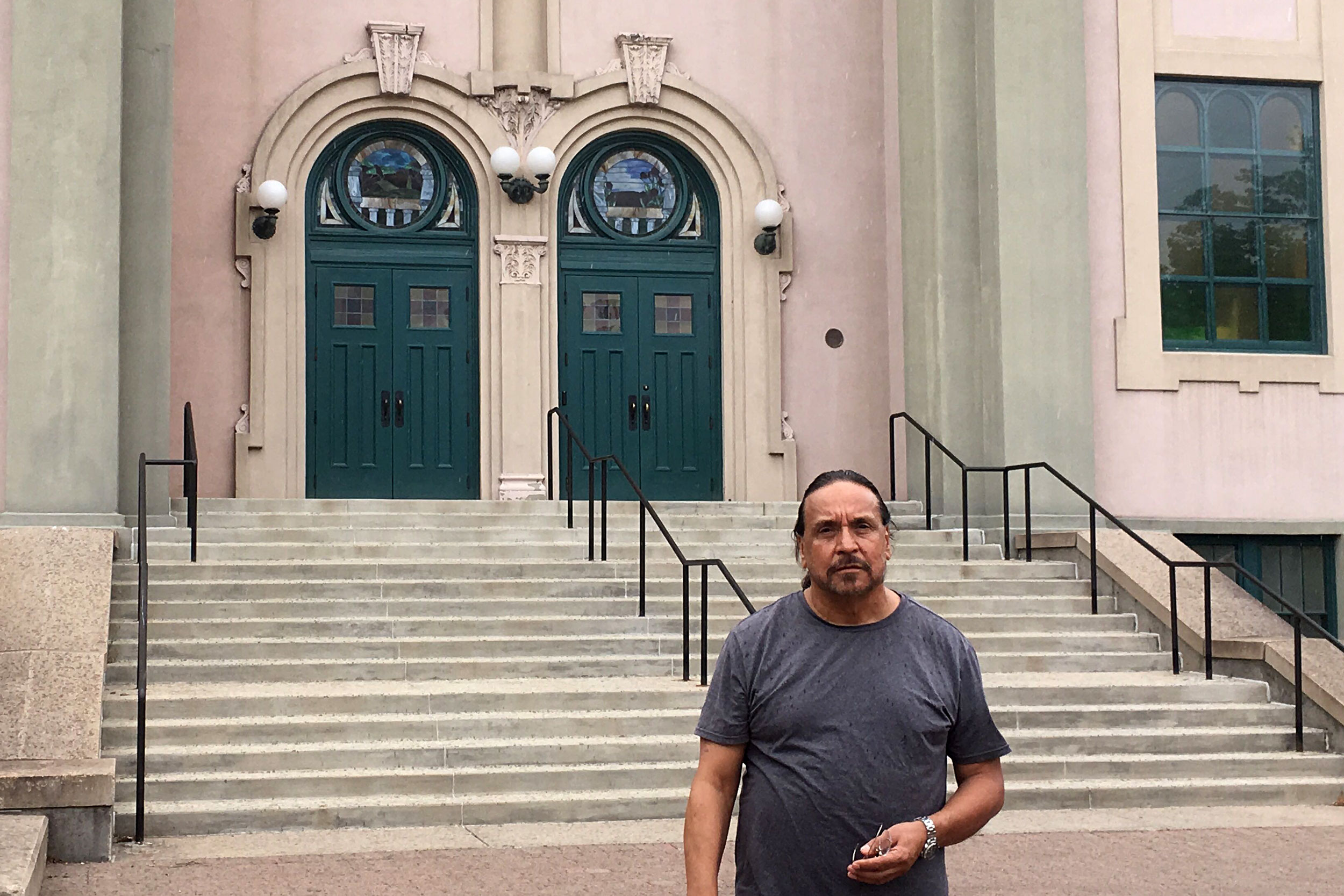 Tony Garcia stands in front of St. Catejan's Church on the Auraria Campus Aug. 8, 2019.