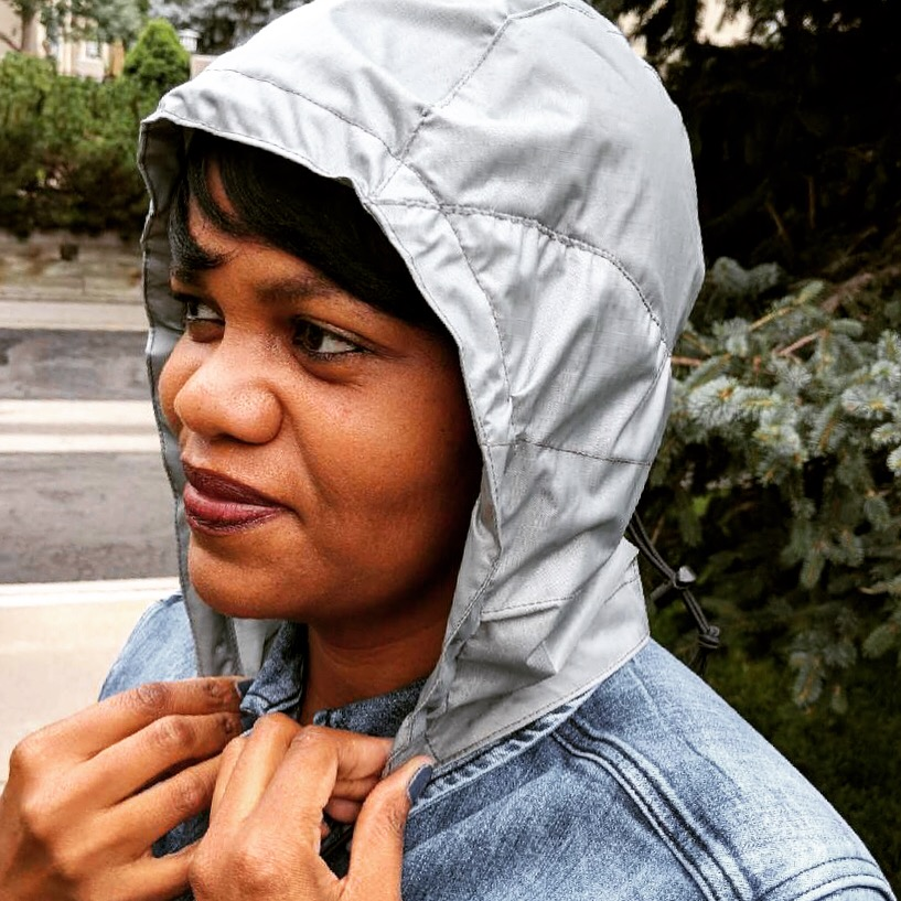 Inventor Sirena Rolfe wears her patented hood designed to protect your hairdo when it rains.