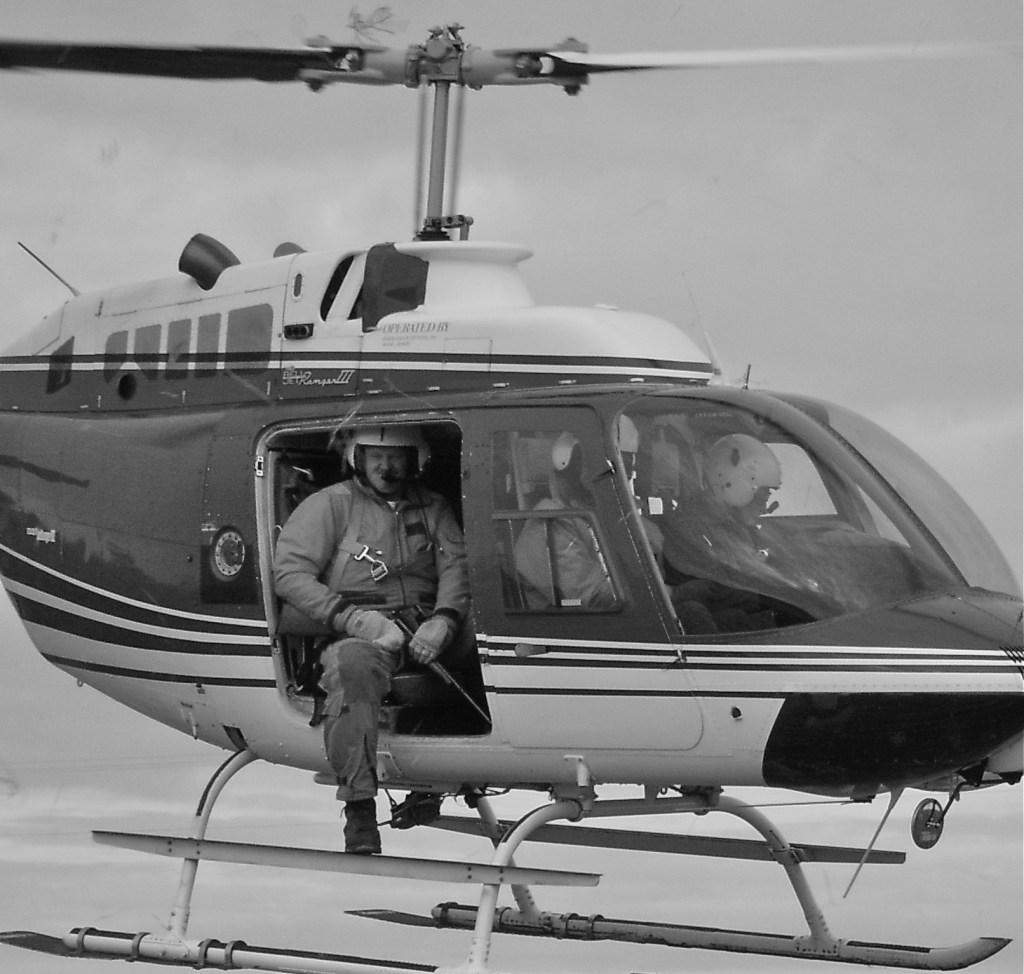 Carter Niemeyer in helicopter with gun