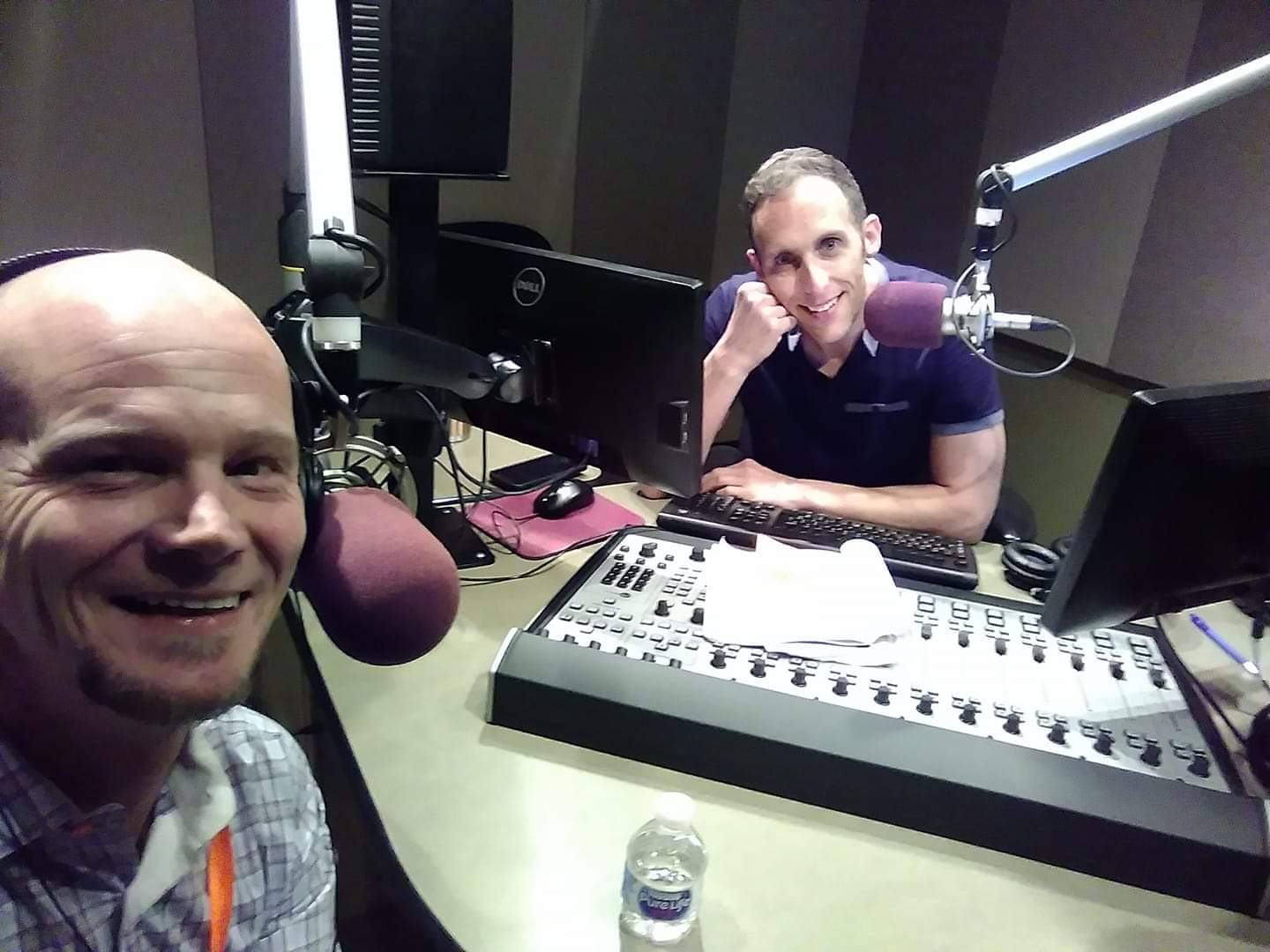 Darin Valdez with Colorado Matters host Ryan Warner at CPR Studios during a break. Valdez works at Sobriety House in Denver as an addiction counselor, after overcoming addiction himself.