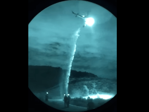 A helicopter in training to fight fires at night