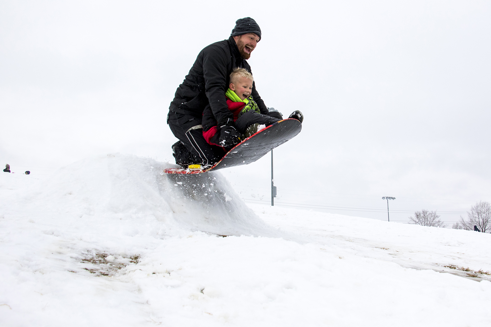 Johnny Borchaedt and his son, Chase, fly over a sled jump at Ruby Hill, Jan. 12, 2019.