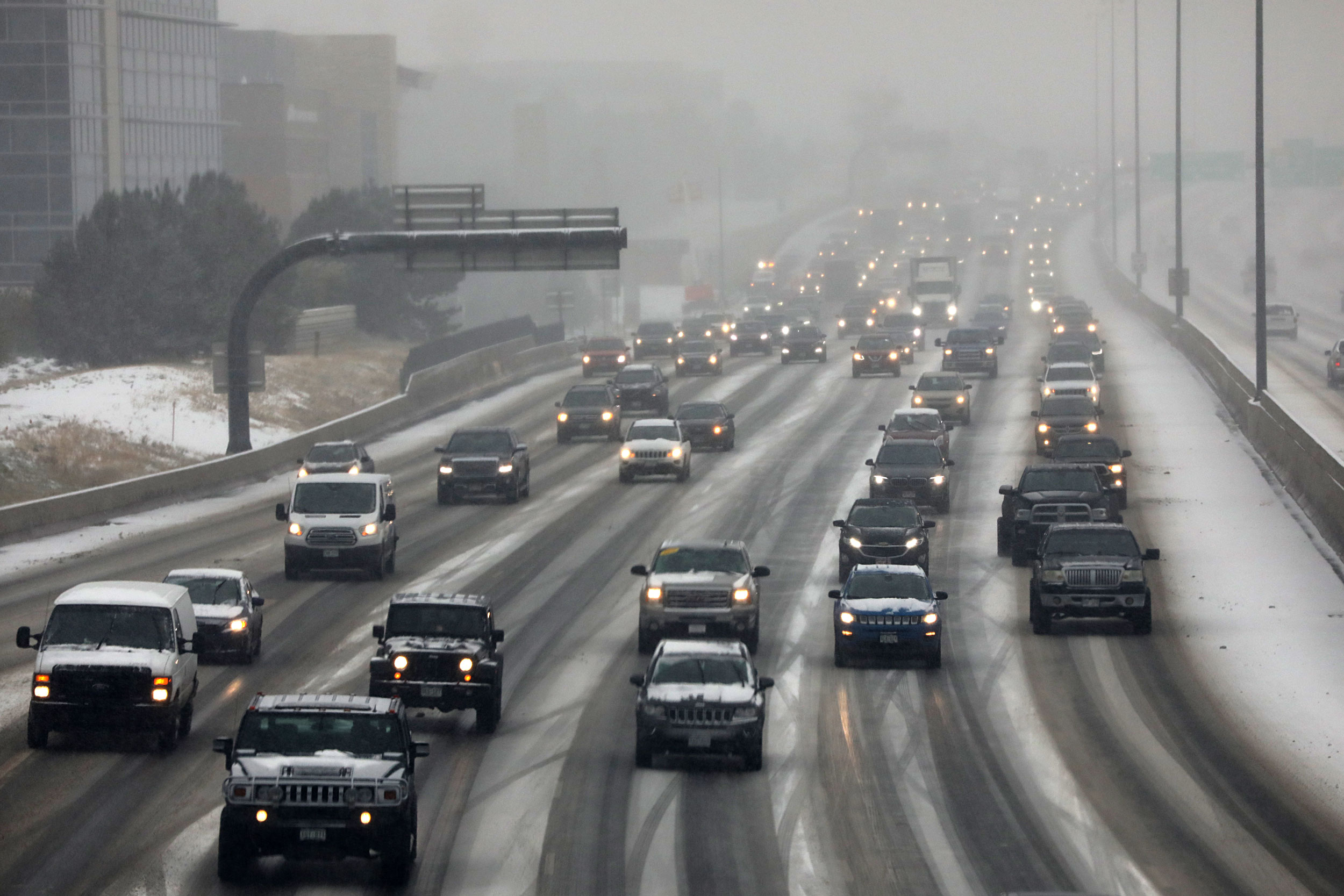 The I-25/Denver metro commute was slow Thursday morning Oct. 10 as the season's first snow fell on the north and central Rockies and the Front Range.