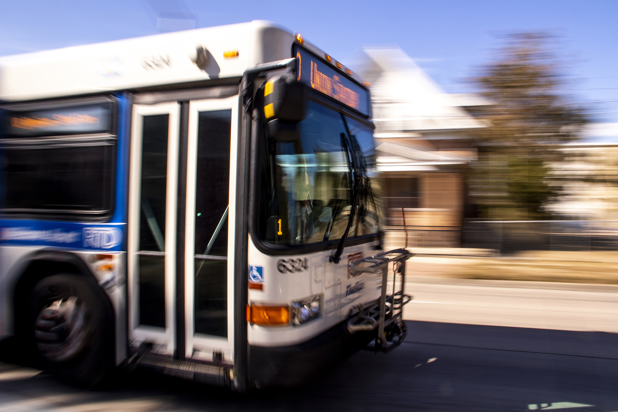 An RTD bus drives up Lincoln Street south of Alameda Avenue. Oct. 15, 2019. (Kevin J. Beaty/Denverite)