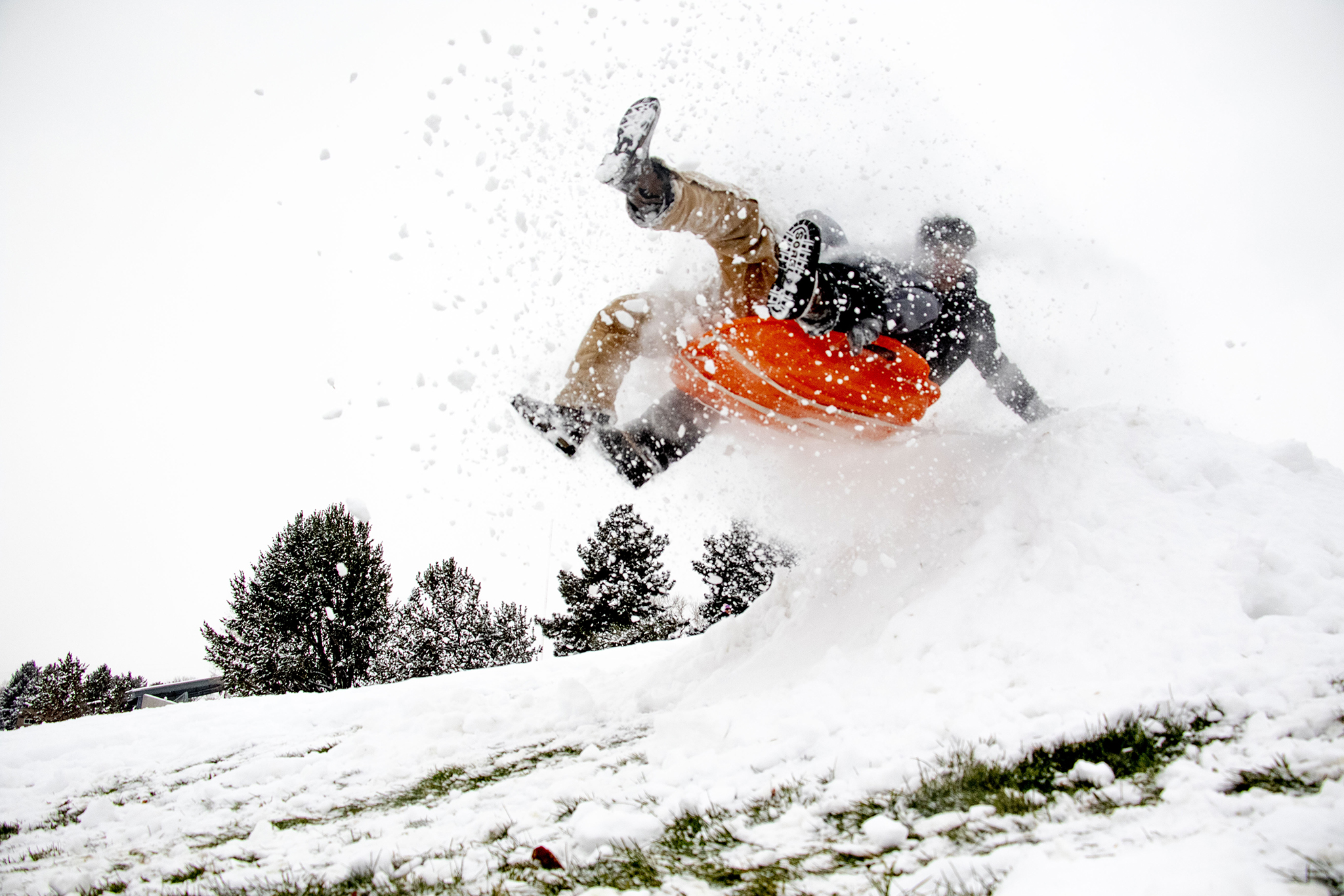Cruz Ortega and Aryel Ramos fly over a jump at Ruby Hill Park on small sled on a snow day, Oct. 29, 2019.