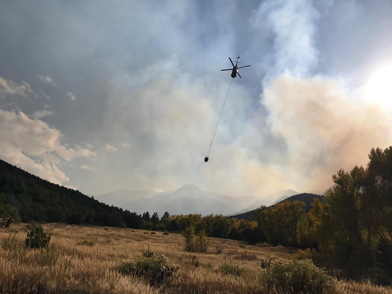 A helicopter flies over the section of Decker Fire last week. The fire has been burning south of Salida for more than a month and has grown to 8,000 acres.