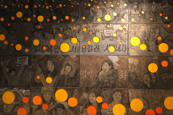 """Detail of """"Tide of Candles II"""" by Lim Oksang at RedLine for the """"CounterART: Aesthetics of South Korean Activism"""" show."""
